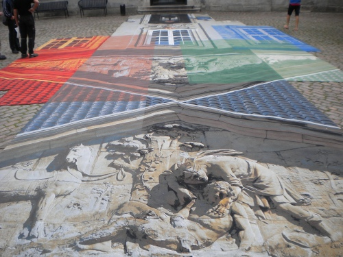 Everything seems to take on an artistic flare here, exampled by this mural sprawled across the sidewalk