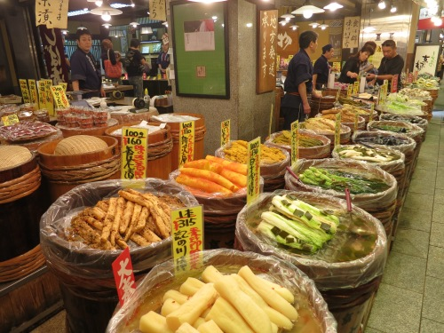Vendors selling their edible wares in the Nishiki Food Market