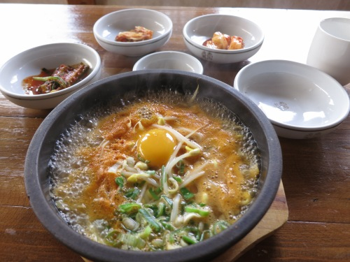 Another dish famous to Jeonju is that of Kongnamul Gukbap, or Bean Sprout Soup -- consisting of glutinous rice, bean sprouts, an egg, and a spicy broth served bubbling away in another stone hotpot