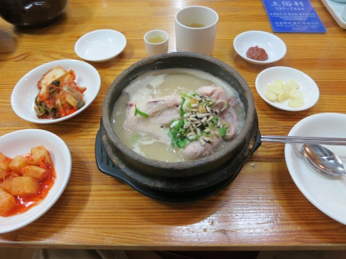 Samgyetang - a soup consisting of an entire young chicken stewed up with ginseng and glutinous rice.  This dish is consumed during the hot and humid summers, as well as a preventative medice for illness.  Additionally, it is usually acompanied by a glass of insamju, or ginseng wine, just to open up the blood vessles and really drive home the restorative qualities of ginseng