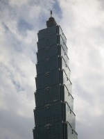 The Taipei 101 building -- created to imitate a stalk of bamboo -- set against the backdrop of a cloudy sky