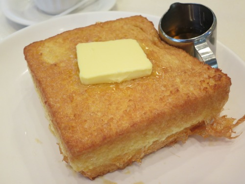 Hong Kong Style French Toast, where a double dose of bread is stuffed with jam or butter, liberally coated in batter, fried in butter, and then topped with even more butter