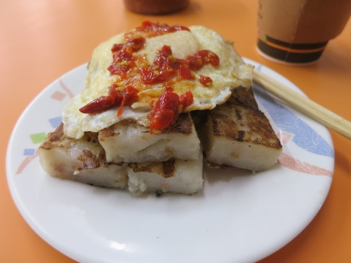 My daily breakfast of lotus cake topped with a fried egg and chili sauce