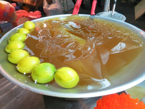 A large tray of the jello-like aiyu jelly, which is served over ice in a lemonade-like drink