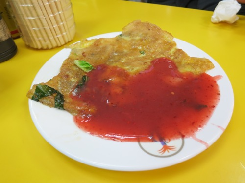 Oyster Omelette with a sweet, fruity sauce ladled atop