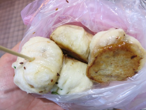 Fried Bao, or small dumplings that are stuffed with pork or veggies and fried up in huge pans until they are ready to burst