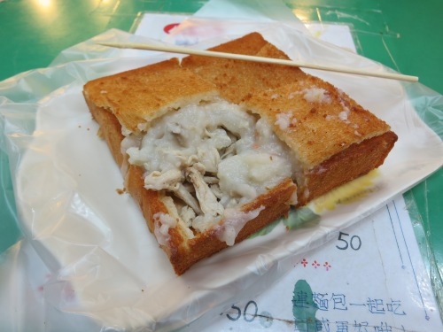 Coffin Bread - a thick slice of bread that hasbeen hollowed out and subsequently stuffed with the ingredients of your choice (this happens to be congee and chicken)