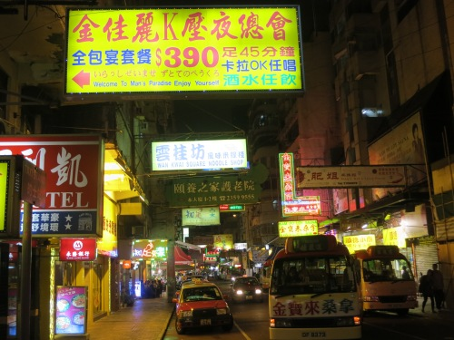 The streets of Kowloon are just as crowded and clausterphobic as those of Hong Kong itself