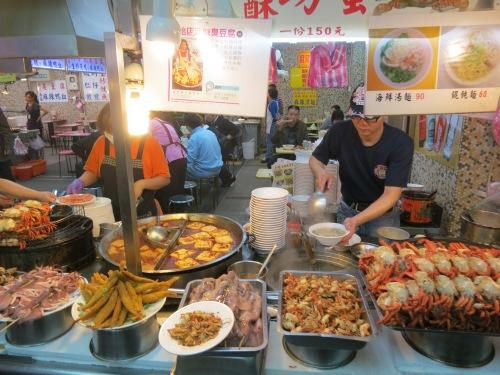 A seafood vendor showing off his edible wares
