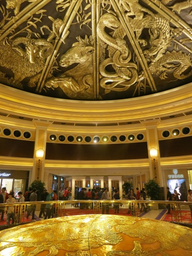 In the foyer of the afor-mentioned Wynn Casino lies the elaborate Zodiac-themed ceiling with retracts to reveal a light show several times a day