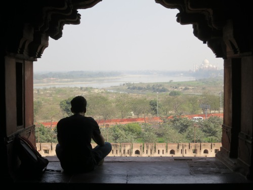 Looking out over the Yamuna River towards the Taj Mahal in the distance
