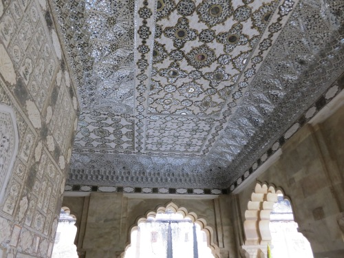 The shiny, mirrored suface of the walls and ceiling of the Jai Mandir (Hall of Victory)