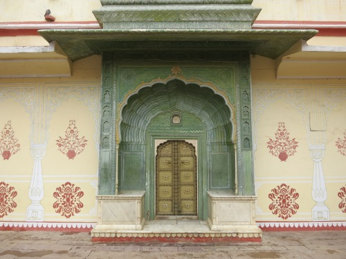 A colorful doorway within the City Palace
