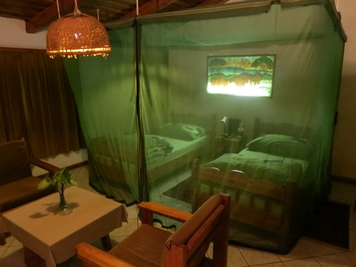 Mosquito nets draping the beds in this hotel in Arusha, Tanzania
