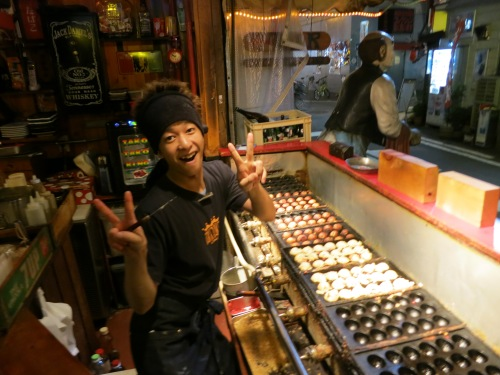 A very enthusiastic Tako Yaki vendor in Osaka, Japan