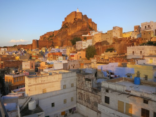 The Mehrangarh Fort perched atop the rocky cliff in the background