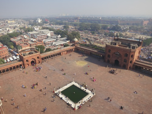The view of the courtyard below, with the walls of the Red Fort visible closer to the horizon