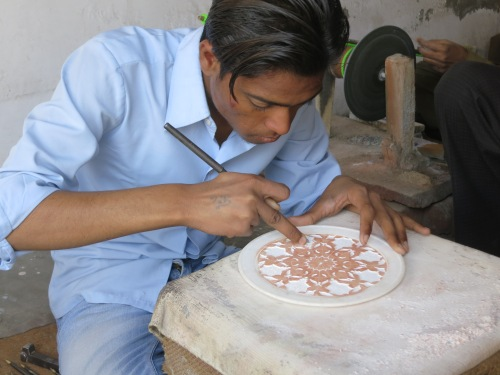 An artisan carved an intricate pattern into marble