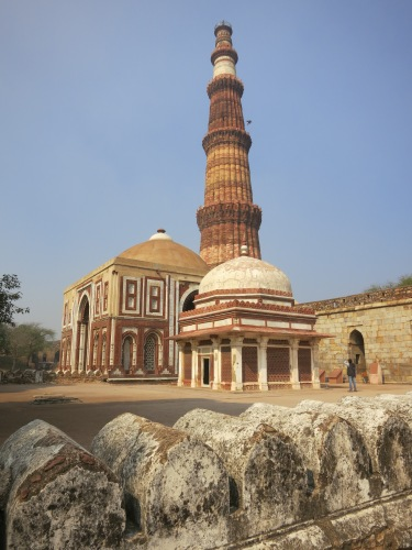 The Qutub Minar, stading high in the background