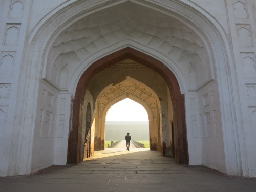 The early morning sun framed by the archway of the Naubat Khana