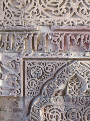 Floral motif designs carved into the sandstone walls