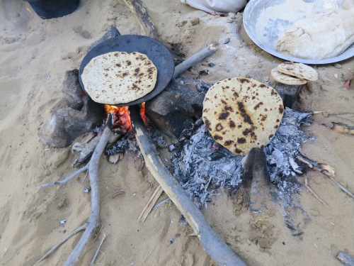 Handmade Chapatis being grilled over the open fire