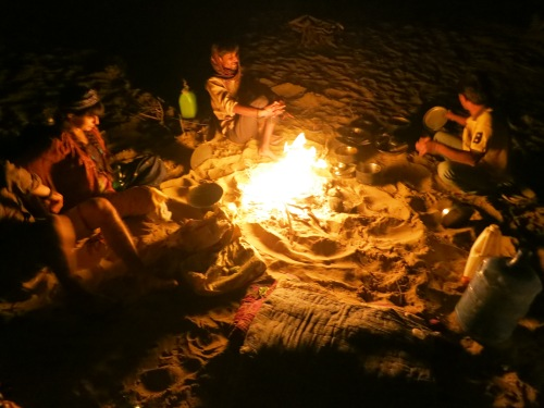 Telling tales and swapping stories over a campfire