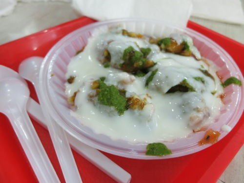 The Indians enjoy mixing together the savory and the sweet, the hot and the cold, to enjoy the contrasts which this implies.  In this case, it was aloo tikki chaat, or savory potatoes covered in sweet yogurt with a dash of the spice from a mint and coriander sauce