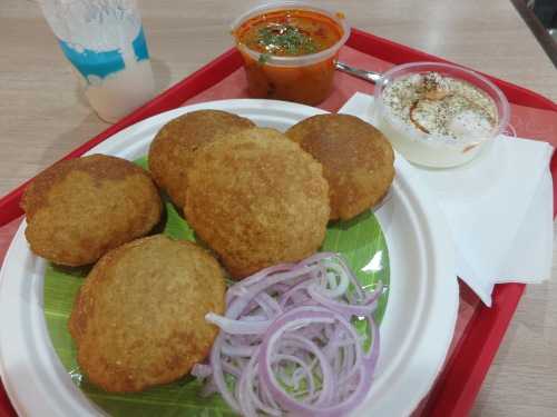 Puri Sabji Pak - hollow balls of puffed dough then you then crack open and fill with a variety of fillings
