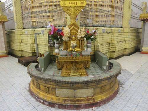 "As is common throughout the country, there are 8 ""stations"" around the base of the pagoda, each corresponding to a particular day of the week (the Burmese recognize 8 days of the week, as opposed to the normal 7), in which visitors are supposed to pray at the altar corresponding to the day on which they were born"