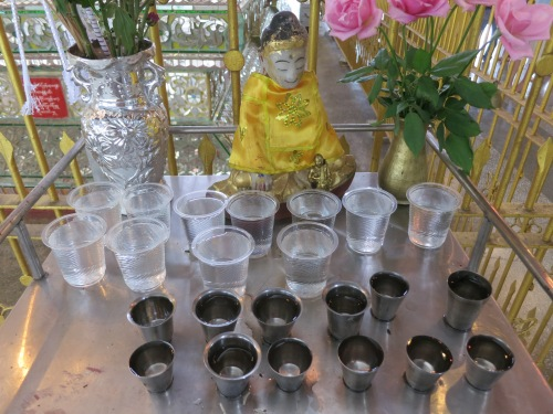 A small shrine set up at one corner of the reclining Buddha
