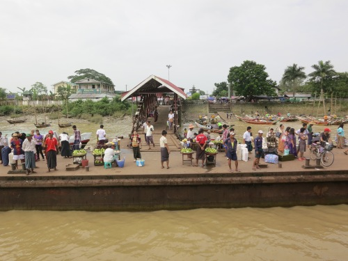 The crowds and vendors awaiting the ferry to arrive at the dock in Dalah