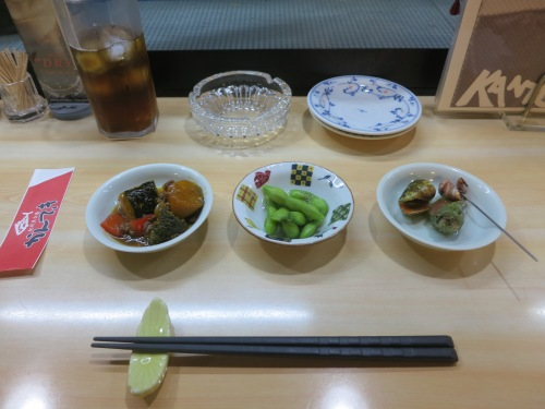 A complimentary trio of appetizers (as seen from left to right: Stewed Pumpking, Edamame, and Sea Whelk, maybe?)