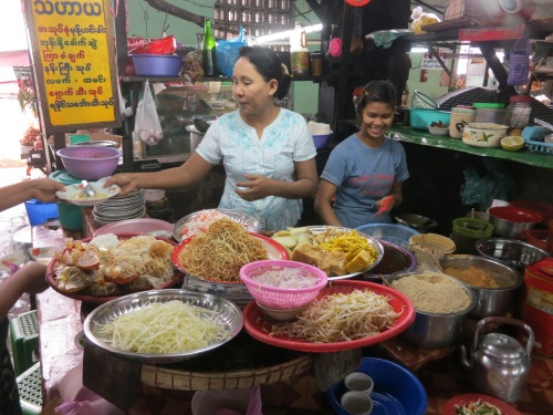 A noodle vendor at a local market selling her delicious wares