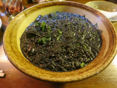 Squid Ink is another common ingredient.  Seen here is a bowl of Ikasuji Jyusi, which is bits of squid, squid ink, and rice cooked in an almost risotto-like manner