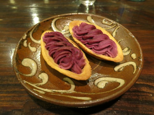 I never caught the name of these cookies (despite the fact that seemingly every store sells them), but they consist of a small, boat-like cookie that is topped with a purple sweet potato filling and lightly charred on top under a broiler
