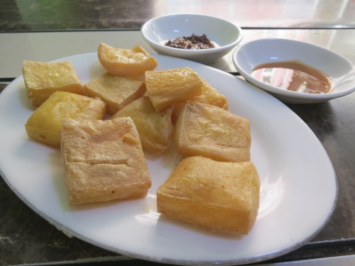 Fried tofu with a spicy dipping sauce is another Shan favorite