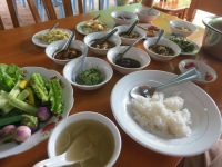 An example of a traditional Burmese meal, in which a series of small dishes (each being unique and distinct) are all served at once alongside a never-ending bowl of rice.  In case you're curious, this particular meal (which included dessert, too) only cost a total of $3