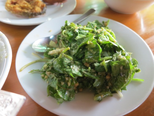 A salad of tender greens and fried shallots