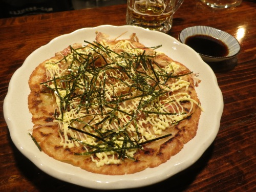 Hirayachi – a crepe-like creation (or pizza, if you will) using an eggy-pancake batter that is then topped in a similar manner to that of okonomiyaki (an Osakan favorite)