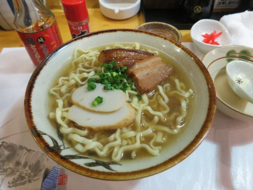 Okinawan Soba, which is centered around a pork-bone-based Tonkatsu broth, to which the island's unique soba noodles are added along with pork spare ribs (and occasionally fish cakes, as seen here)