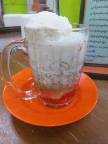 A glass of Falooda, another Indian-influence dessert consisting of a plethora of different grasses, jellies, and squigglies drowned in a sweet yogurt-like foam
