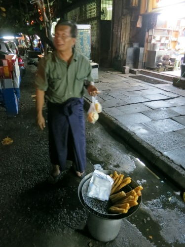 A very energetic Ee Jaw Kway vendor who could hardly stand still long enough for me to take his picture (this guys is also kind of famous, as he is the only one making these Chinese-style dough sticks at night)
