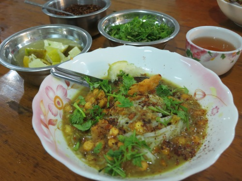 Mohinga, the king of noodles dishes.  This breakfast staple is a dish of thin rice noodles served in a fish broth that is then topped with a variety of toppings, including chili, lentils, crispy bits, lemon, and a few herbs