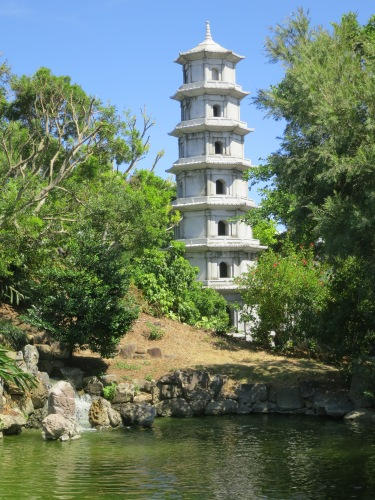 A pagoda towering over the mouth of a bubbling stream
