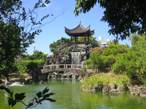 The primary pavilion and waterfall of the Chinese-style Fukushu-en Garden