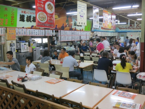 A series of bustling restaurants occupy the second floor of the market, all taking advantage of the proximity to the market below.  In fact, you can even purchase your seafood or ingredients down below, carry it upstairs, and then have one of the restaurants cook your chosen fish to order