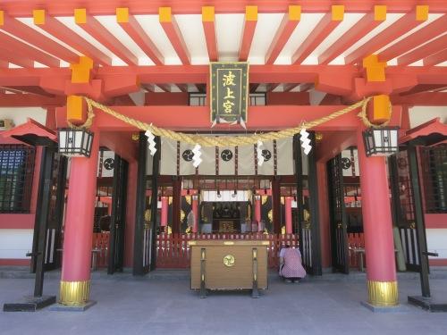 In silent prayer at the Naminoue Shrine