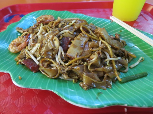 Char Kway Teow -- a favorite noodle dish from the streets of Penang that has been readily adopted by the Singaporeans