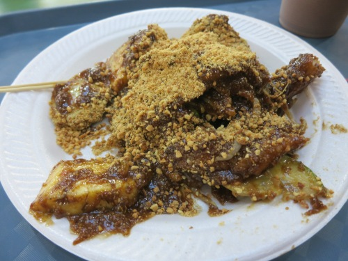 Rojak -- a mix of fruits, vegetables, deep-fried bits, and whatever else the chef wants to throw in, all mixed together in a spicy-sticky sauce and topped with crushed peanuts.  It sounds as though it shouldn't work, but somehow it does.